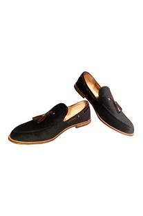Black velvet loafers with tassel detailing