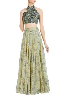 Halter neck choli with embroidered lehenga.