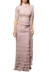 Lilac mermaid style layered skirt with peplum top & embrodiered dupatta.