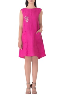 Pink linen tunic with embroidered floral motifs.