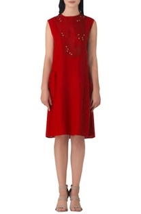 Red linen embroidered dress with over-sized pockets.