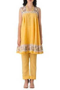 Bright yellow linen anarkali with embroidered floral motifs.