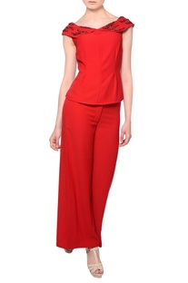 Red bead embellished blouse with flared trousers