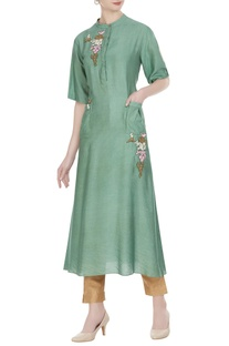 Long tunic with utility pockets