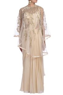Pale beige sari gown with embellished cape