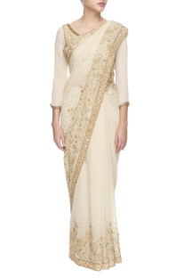 White and golden sequined chiffon sari with blouse