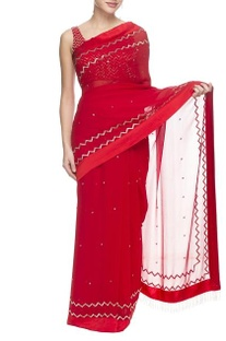 Red embellished sari and blouse