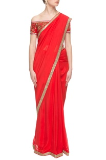 Red sari with embroidered off-shoulder blouse