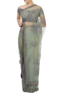Light green sari with purple blouse
