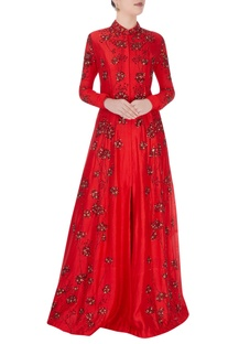 Red high collar gown with shiny bead detailing
