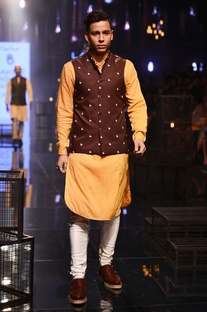 Yellow kurta, white churidar & wine bandi