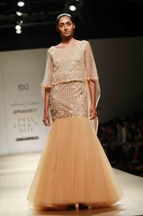 Apricot embellished cape gown