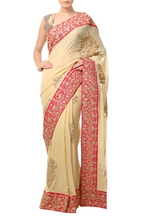 Golden beige embellished sari with wide border