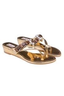 Dull golden platforms with stone embellishments