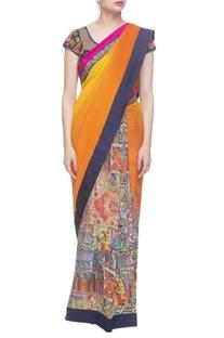 Orange madhubani printed sari with kutchi embroidered blouse