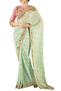 Mint green embroidered sari with a peach blouse