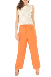Ivory embellished crop top with orange trousers