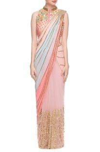 Pastel sari with peach embellished jacket choli
