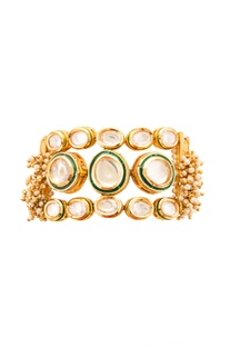 Gold plated kundan studded bracelet with pearls