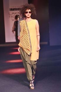 Orange asymmetric kurta with drape