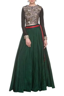 Black embellished crop top with emerald green skirt