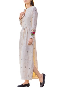 Off-white mirror work long dress with side slit