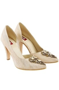 Cream stilettos with brooch