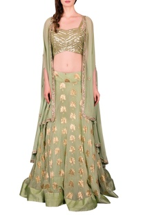 Green lehenga with embellished blouse and cape