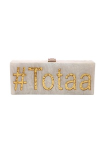 White & gold 'Totaa' monogrammed clutch