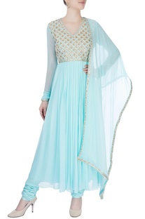 Blue anarkali with golden hand embroidery.