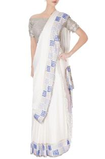 White sari in silver sequin work