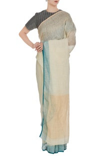 Beige linen hand woven saree with blue border & unstitched blouse