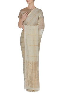 Ivory grid patterned hand woven linen saree with unstitched blouse