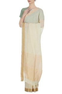 Vanilla linen hand woven zari work saree with unstitched blouse