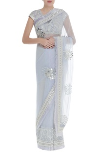 Embroidered blouse with fringed saree