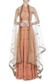 Halter blouse with embroidered lehenga and cape