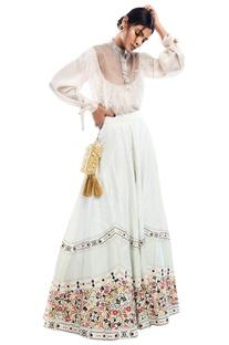 Sheer net yoke blouse with floral printed flared lehenga