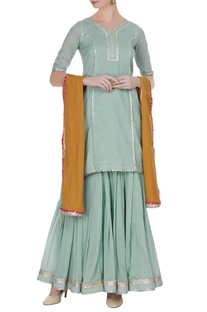 Tailored kurta and sharara pants with contrast dupatta.