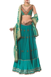 Sleeveless blouse with embroidered lehenga and banarasi dupatta
