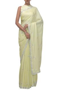 Silk satin sari with studded sleeveless blouse