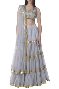 Tiered cutdana raw silk & net lehenga set