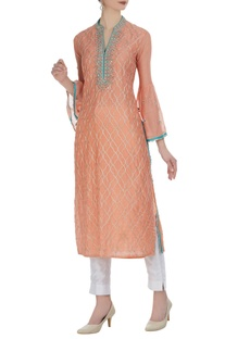 Straight kurta with mirror work.