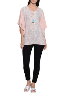 Side flare embroidered top