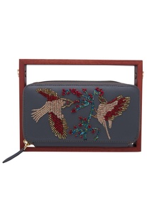 Beaded circular clutch with wooden handle