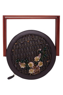 Embroidered circular clutch with wooden handle
