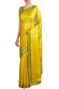 Sequin border embroidered sari with sleeveless blouse