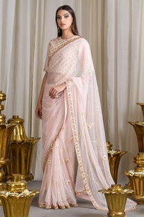 Pale pink embroidered sari with blouse