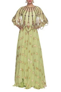 Mint green dress with embellished cape