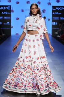 White embroidered crop top and flared skirt