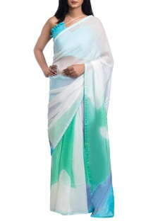 White brush painted saree with blue & green motifs
